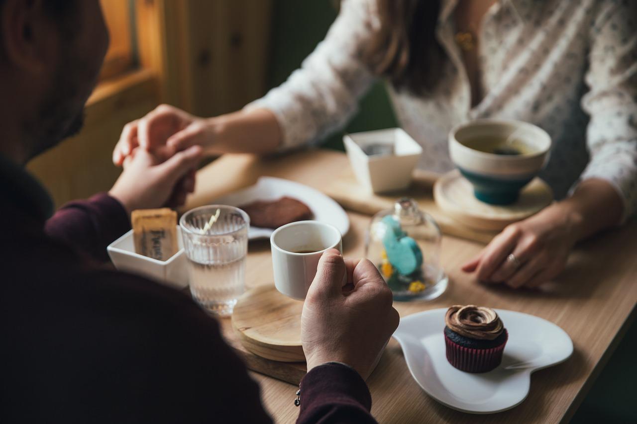 Couple having breakfast coffee & pastries